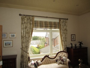 Roman Blind behind a curtain