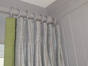 Pinch pleat curtains hung correctly.